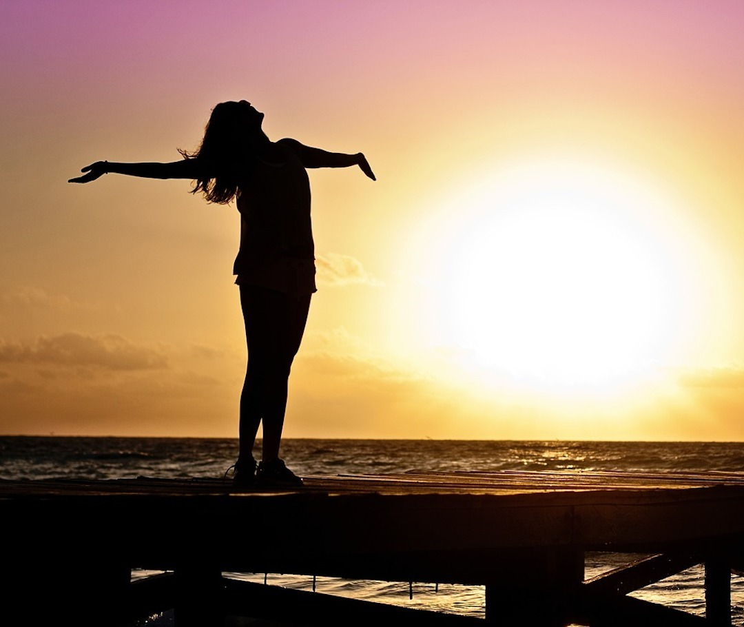 Arms outstretched embracing good health