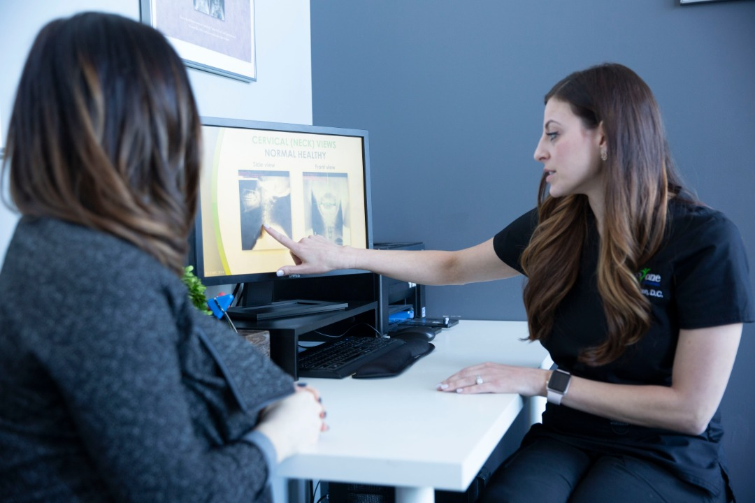 Chiropractors adjusting people
